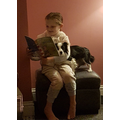 Reading to Alfie the dog.