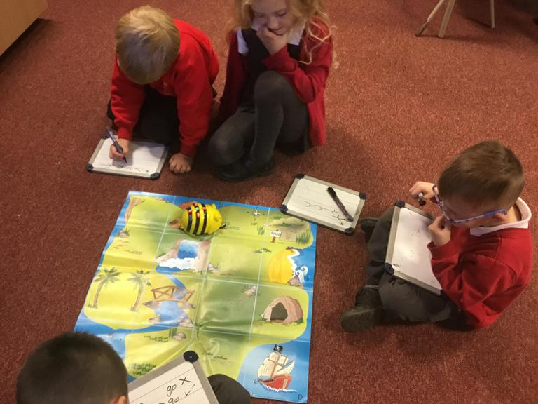 Programming the Bee-Bots to travel across the map!