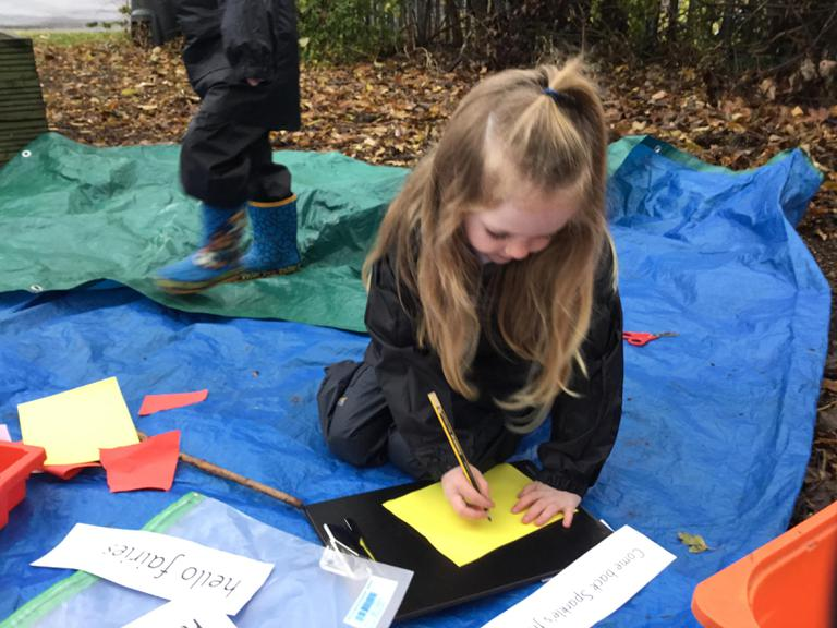 Making flags to welcome the fairies back