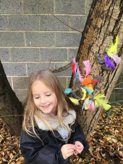 Making happy colourful faces on the trees