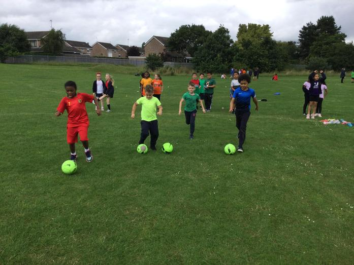 Practising our ball skills!
