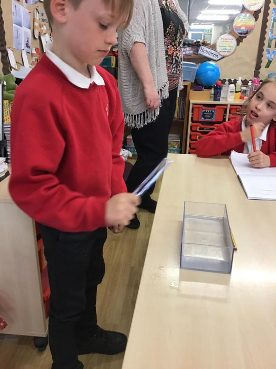 Tapping a tuning fork against a hard surface and then placing in a container of water.