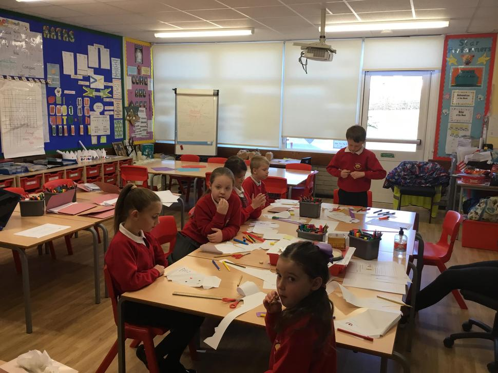 Designing their own packaging for a sandwich.
