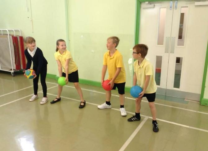 Year 5 practising ball skills.