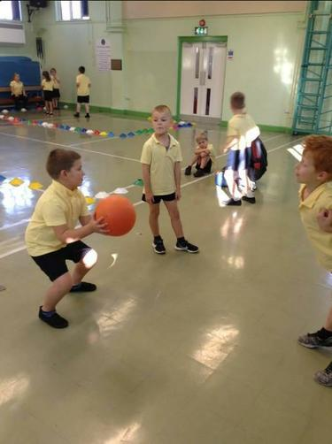 Year 2 working on their throwing & passing.