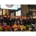 Year 2 reading a Harvest poem.
