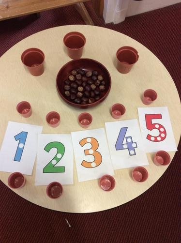 Counting, emptying and filling with conkers.
