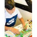 Ollie working hard on his Monet bridge drawing.