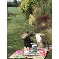 Lyra painting her Tudor house.