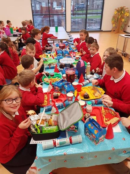 Everyone enjoying lunch in the dinner hall