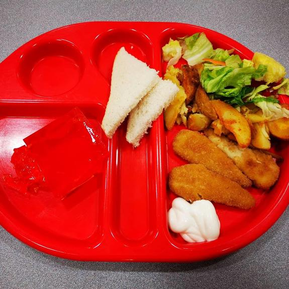 Crispy Chicken served with wedges, salad and dips
