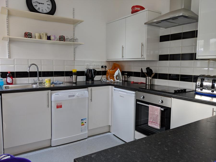 Kitchenette equipped with dishwasher, washing machine, electric hob and oven, microwave, fridge freezer and separate fridge
