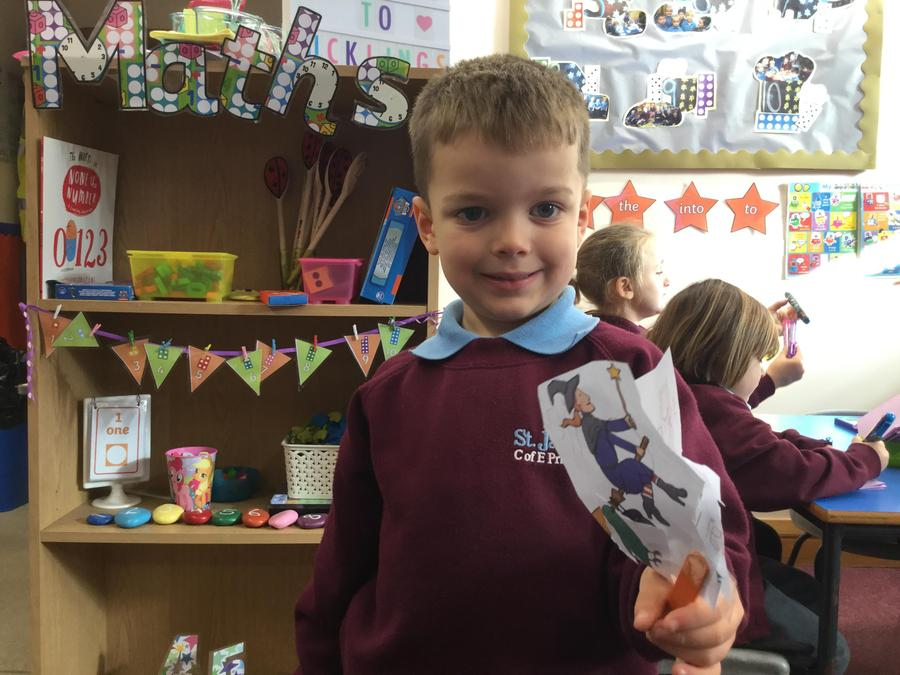 Cutting out puppets to retell the story