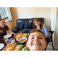 Jack and his parents enjoying the pizza