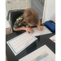 Charlie working hard with his maths work