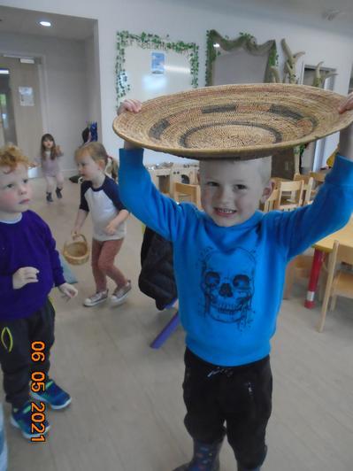 We tried to balance a basket on our heads like Handa.