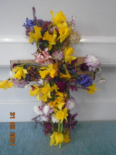 We decorated a cross with flowers for Easter.