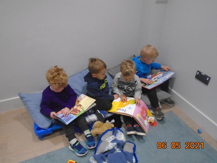 We enjoy a bit of quiet time to sit and share books.