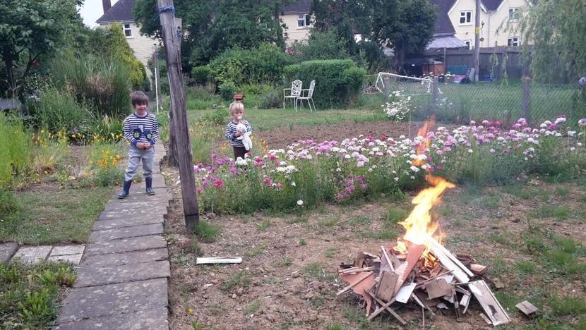 Oscar having a bonfire
