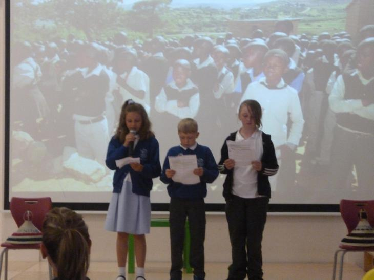 Year 5 and 6 telling the audience about Lesotho