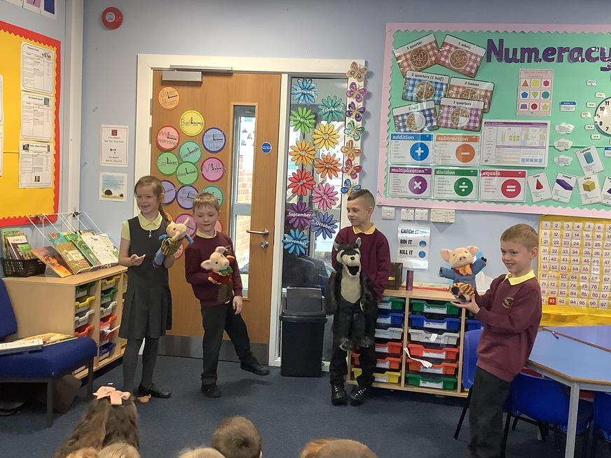 Enjoying retelling the story of The Three Little Pigs with our story sack!