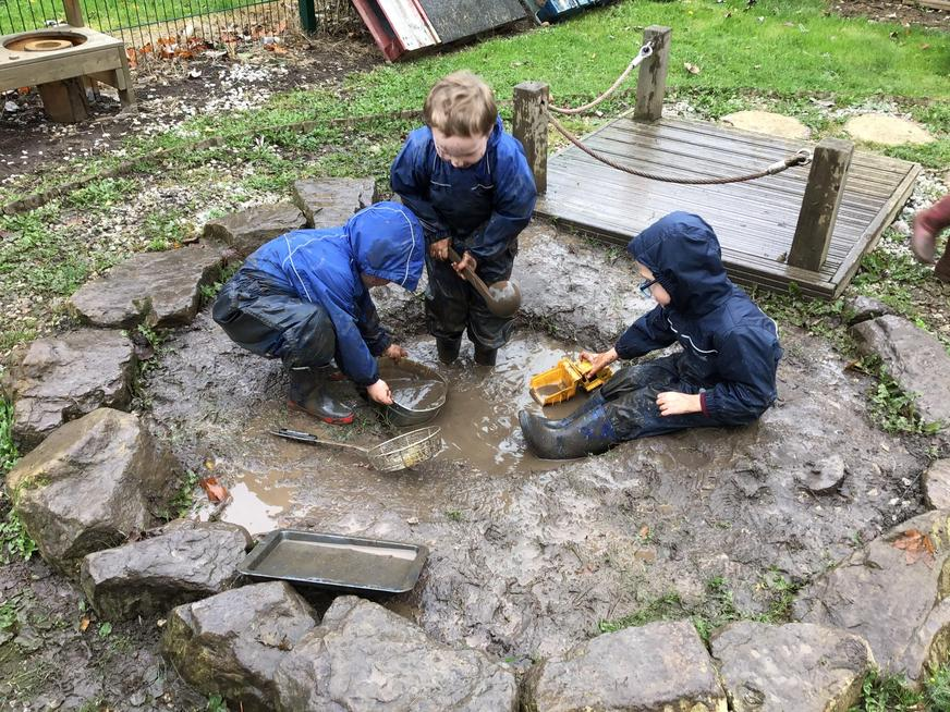 Investigating and exploring muddy puddles.