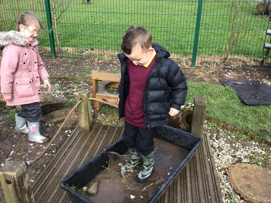 Having fun in the muddy puddles!