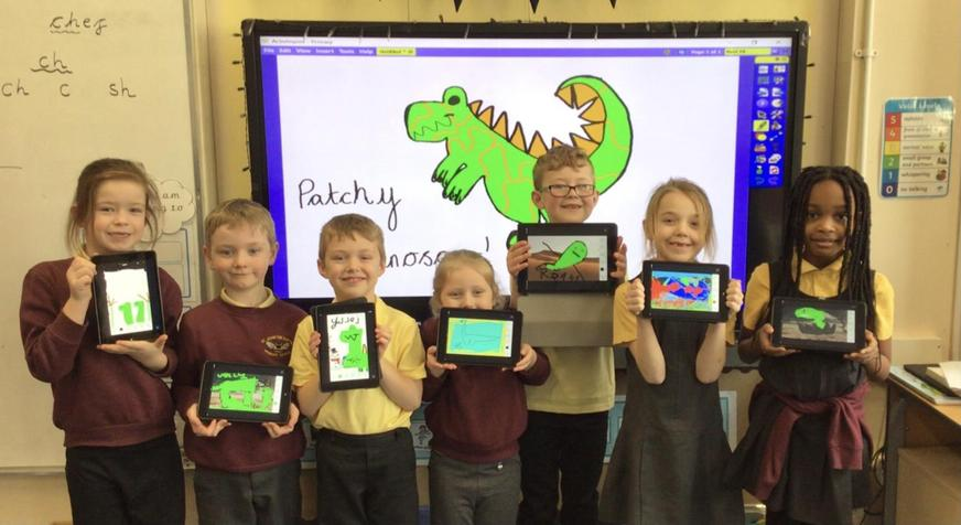Using the I pads to draw dinosaurs