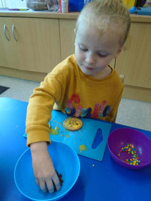Decorating biscuits for World Mental Health Day.