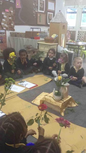 As a reflection we lay flowers around Mary whilst listening to special hymns about Mary