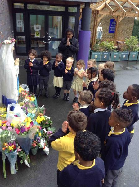 We visited our statue of Our Lady of Fatima to lay flowers and pray