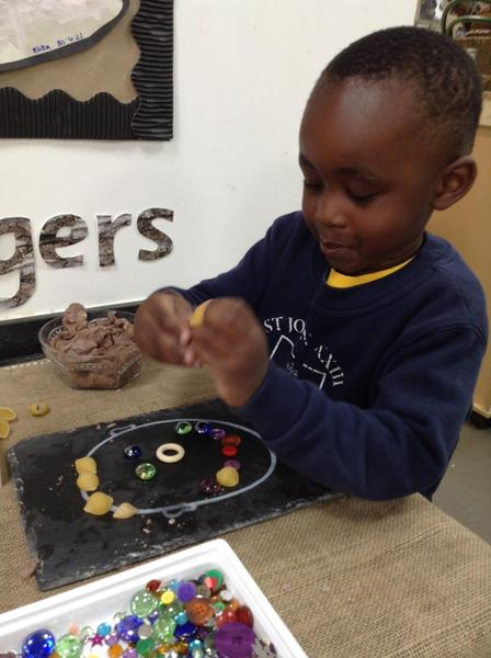 We made happy faces using loose parts in RE.