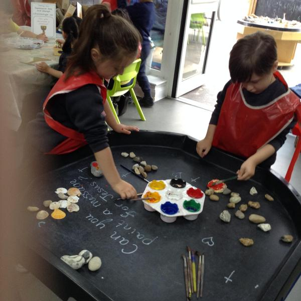 The children chose to create messages for Jesus by painting on shells and stones.