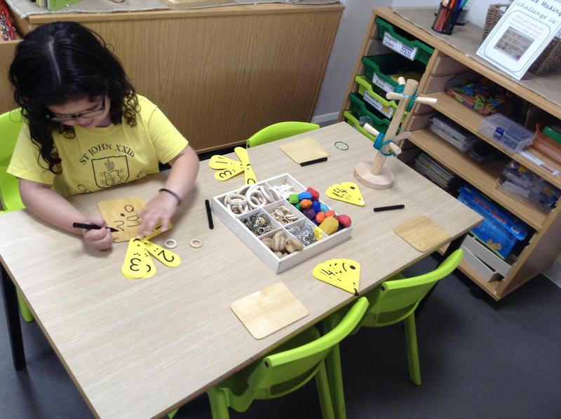 The children have been exploring representing numbers by making marks and writing numerals