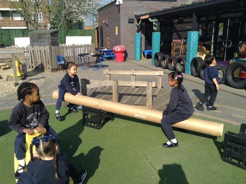 The children used the loose parts outside to make a seesaw.