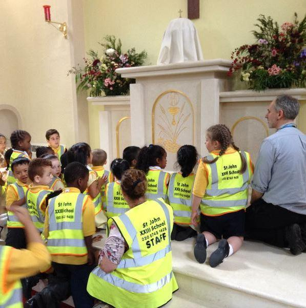 Adoration with Fr Richard in EYFS