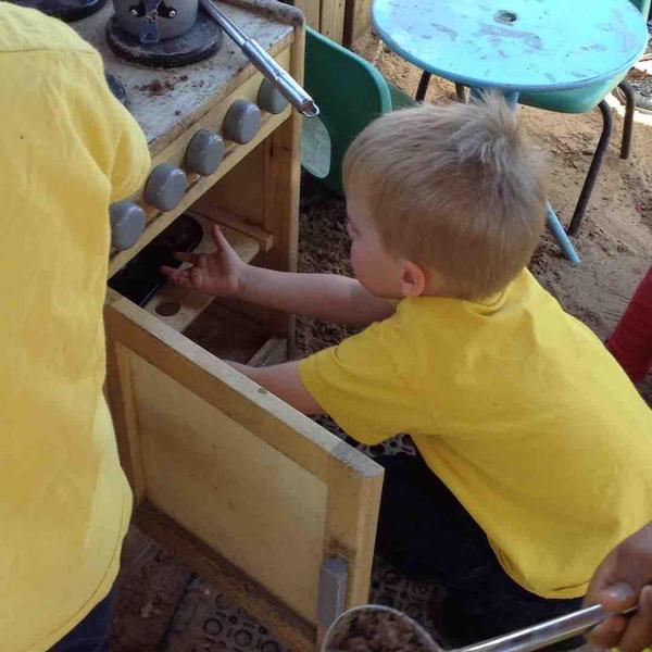 Malleable experiences in our outdoor mud kitchen. Fancy a mud pie?