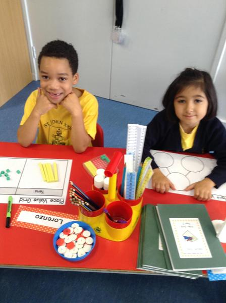 We love working together and using different Maths resources to figure things out!