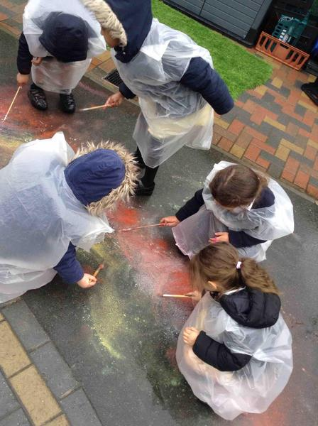 Our creativeness is not confined to the classroom! Check out our puddle painting.