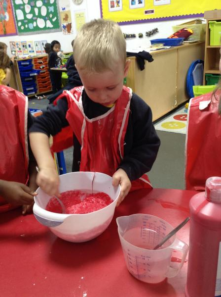 Mixing red, glittery playdough