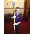 Dan carrying the ceremonial mace