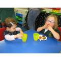 Isla and Ella enjoying their snacks.