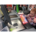 Having a go on the tills