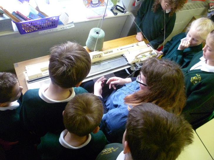 Having a go on the knitting machine!