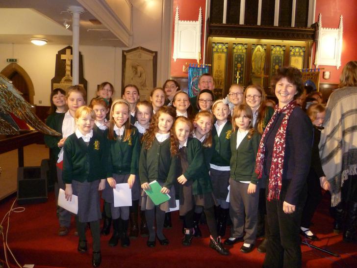 Mrs Winson-Bushby and her wonderful choir