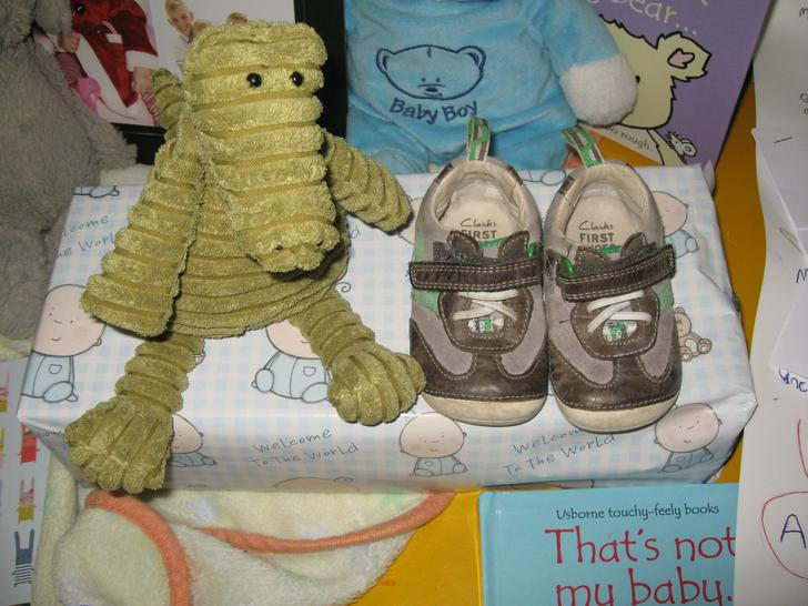 Here are Daniel's first shoes & Frank's first toy.