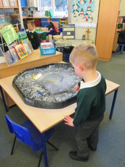 Mark making in our snowy glue and glitter mix