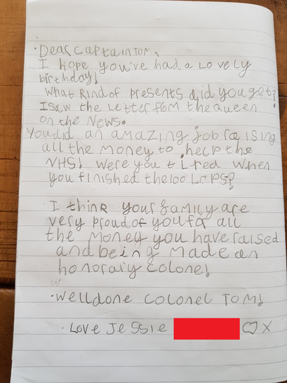 Writing a letter to Captain Tom.