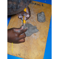 shaping the clay with tools