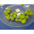 Snipping grapes into small bunches